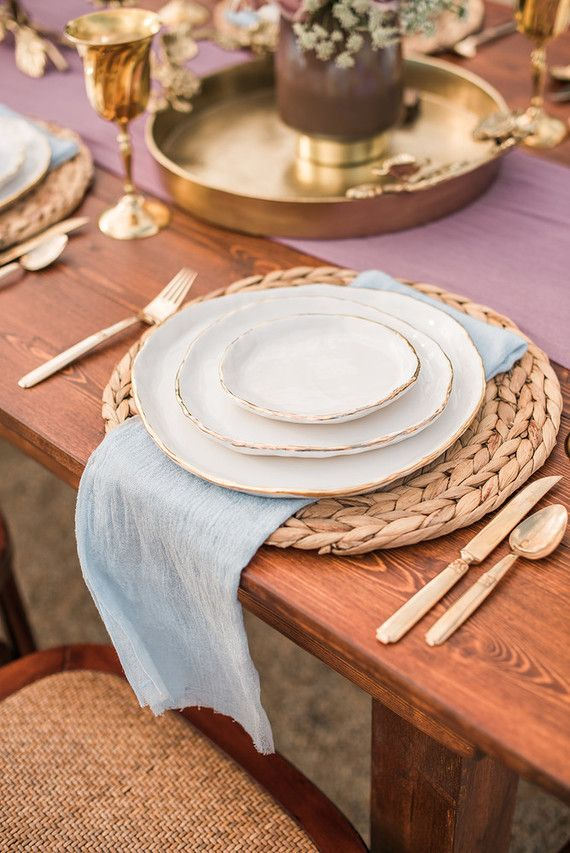 Rustic Place Setting With Light Blue Linen Napkin Gold Flatware Rattan Placemat Coastal Table Decor Dinner Table Setting Table Setting Decor
