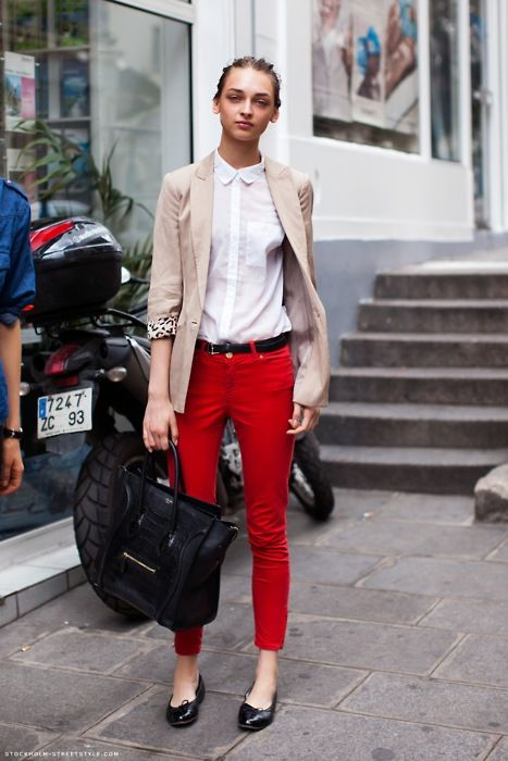 red pants, white button up, black belt