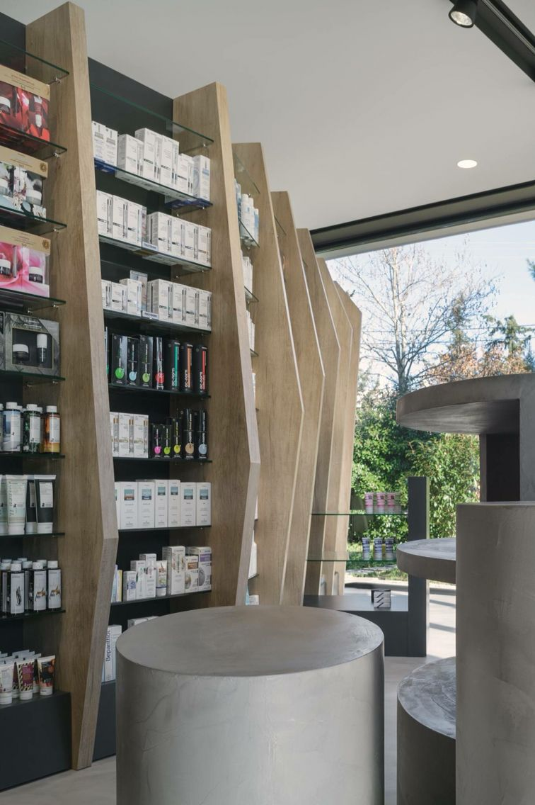 Cure and care pharmacy shop athens pharmacy design for Retail interior design