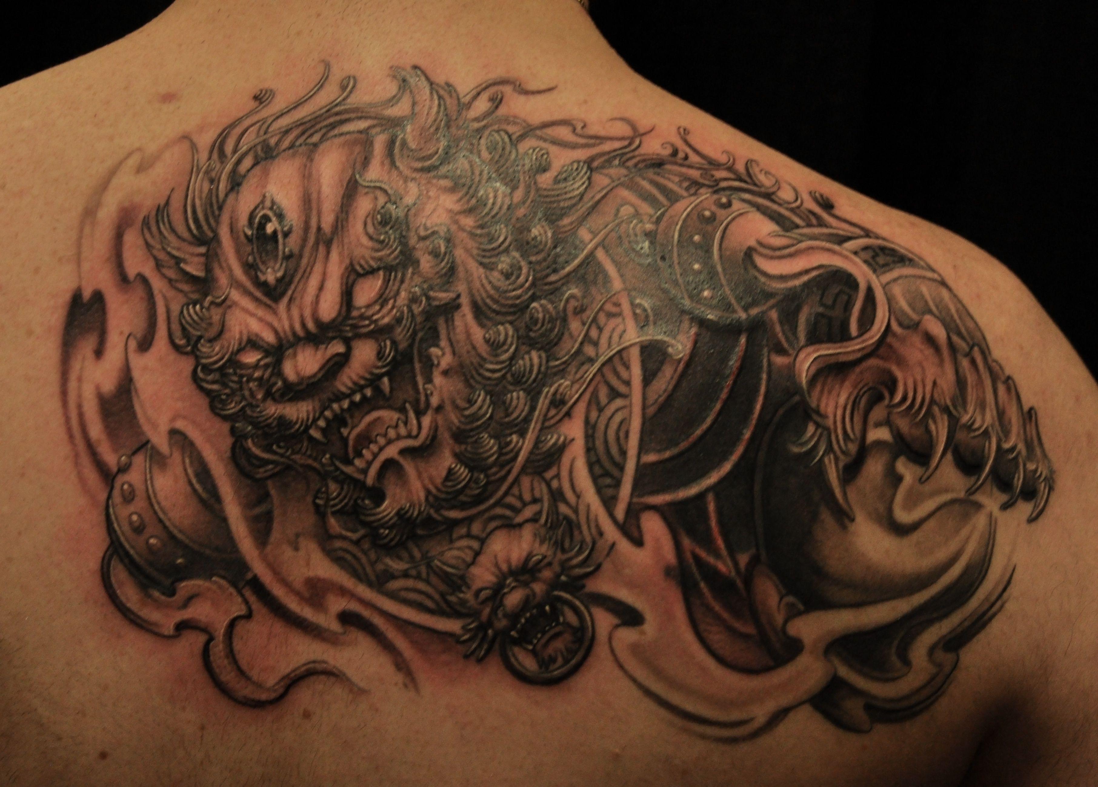 d48d854b38429 beautiful fu dog tattoo upper back | Sooper Mag | Asian tattoo ideas ...