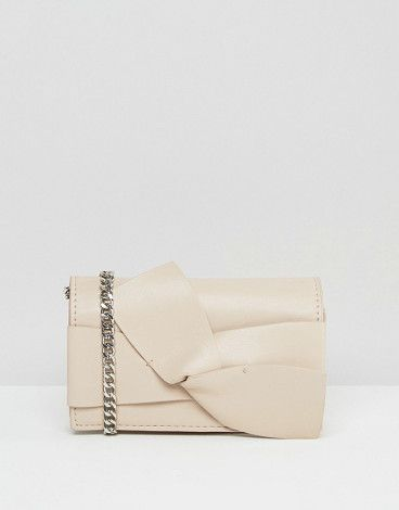 Bow cross body bag by MANGO. Cart by Mango, Faux leather outer, Chain body strap, Front flap closure, Bow detail, Interior zip pocket, Do not wash...