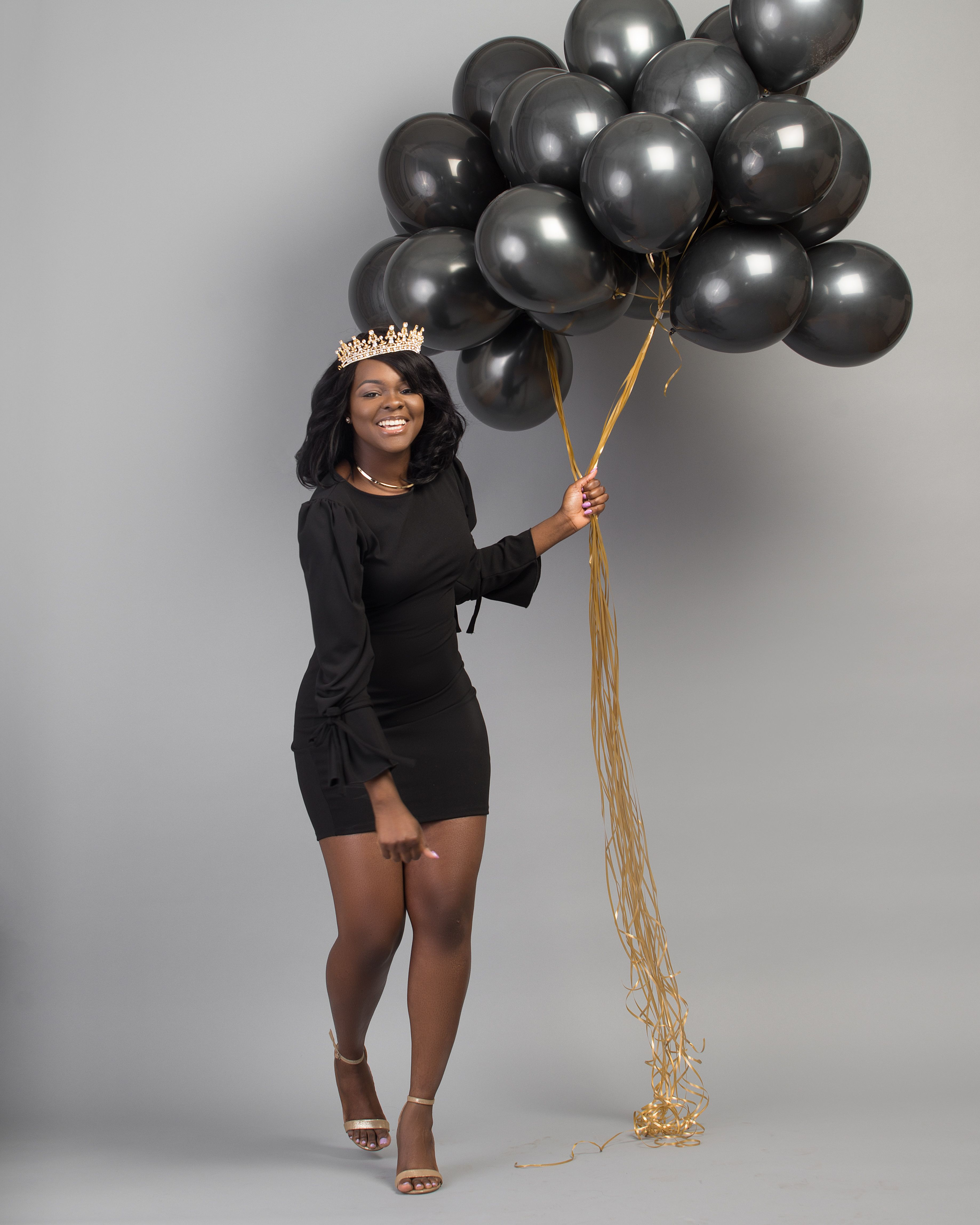 All black with a touch of gold 25th birthday photoshoot for African photoshoot ideas