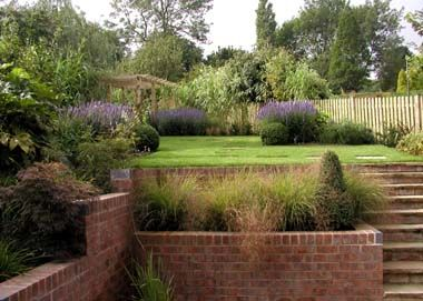 Sloping garden skarpa slope pinterest retaining wall for Garden designs for slopes