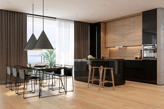 salle à manger ouverte vers la cuisine avec îlot central en noir et