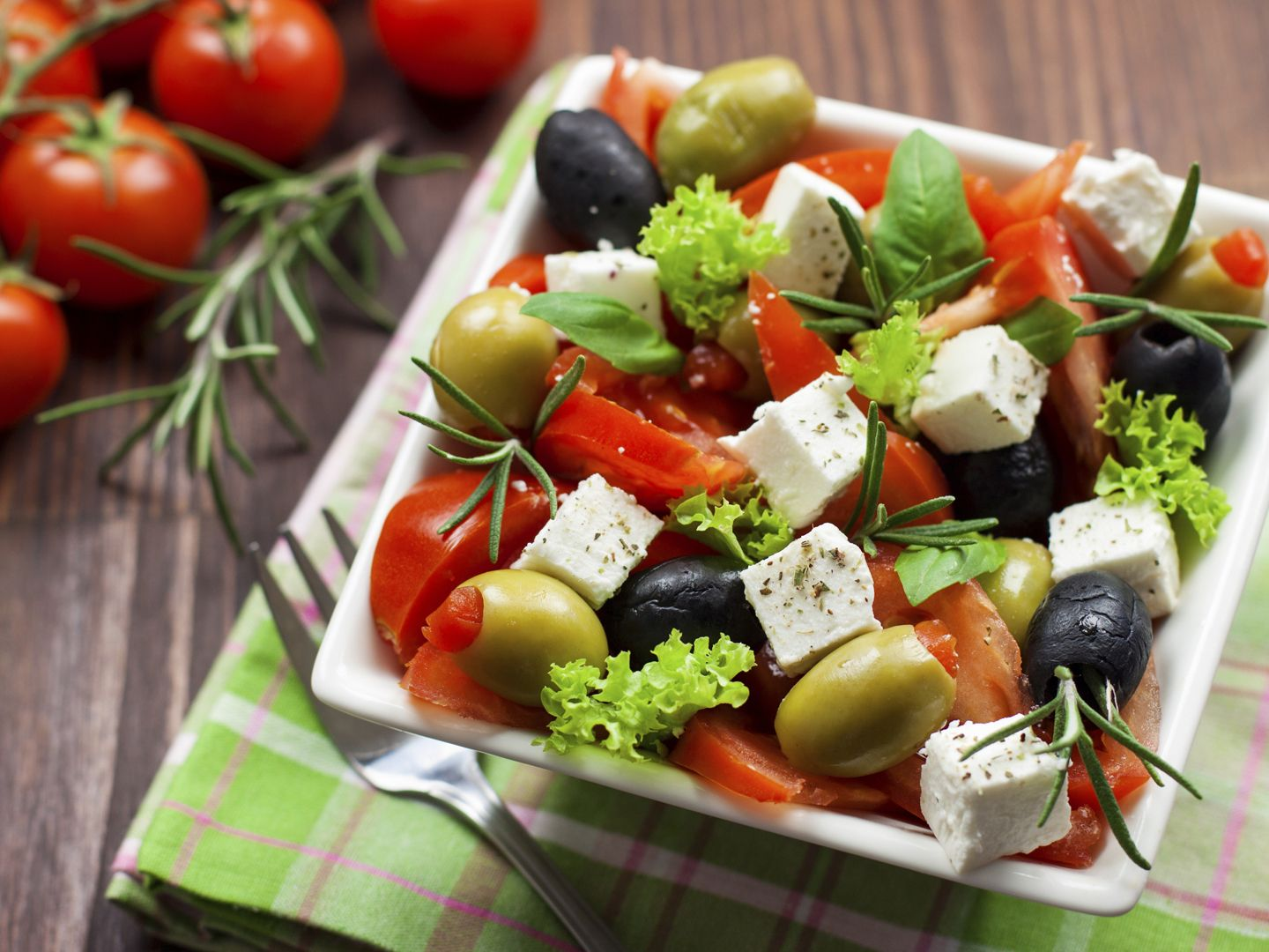 Make this Greek Salad only with the ripest garden tomatoes. If your cucumbers are young, you can leave the immature seeds in!