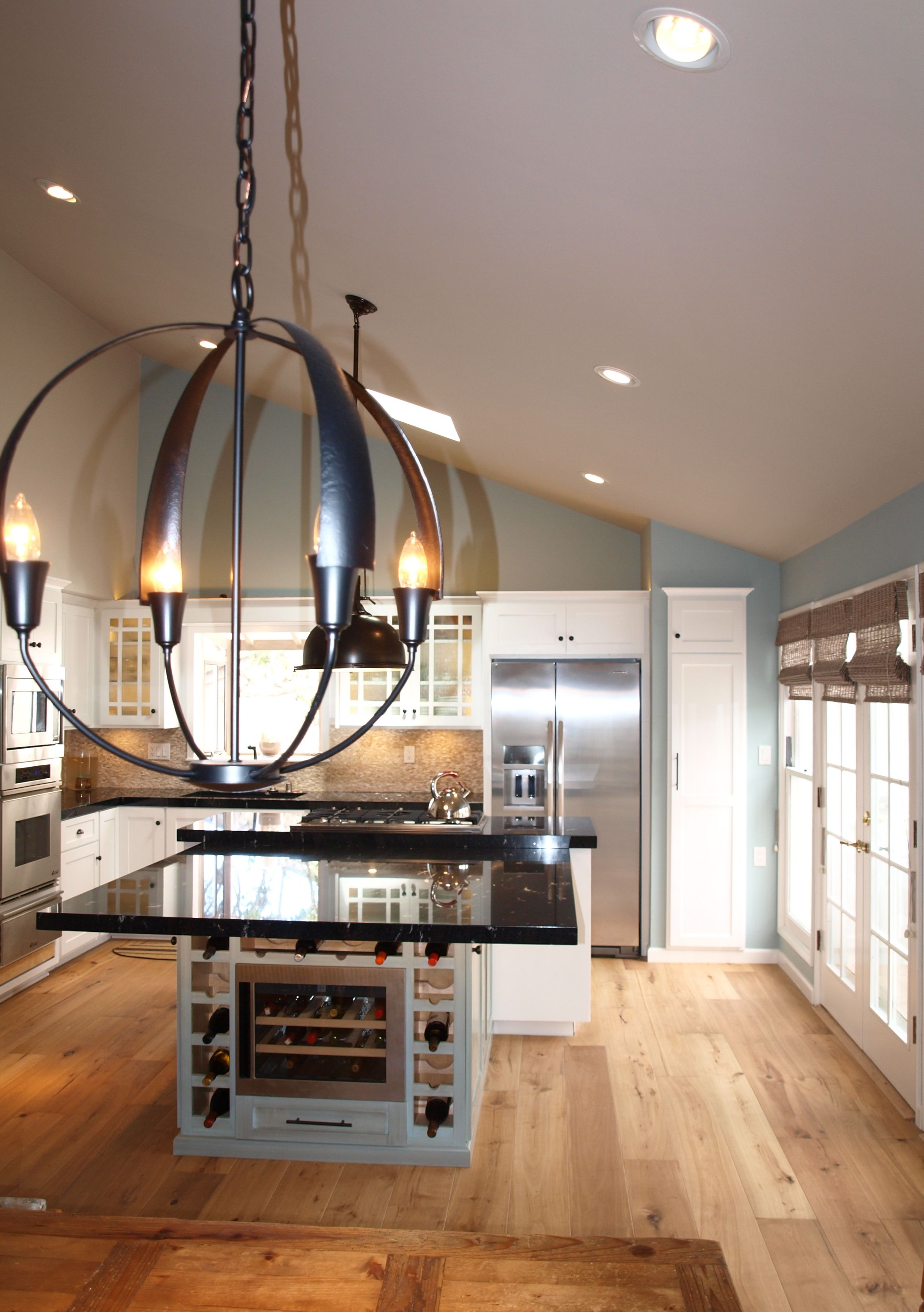 View Of The New Cirque Lantern Dining Light By Hubbarton Forge And A Freshly Remodeled Black Blue And White Ki Dining Lighting Rustic House Beautiful Kitchens