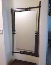 A hammered brass mirror