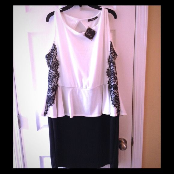 White and black peplum dress Black and white peplum dress with lace detailing on the side and large keyhole back. Pinc Dresses