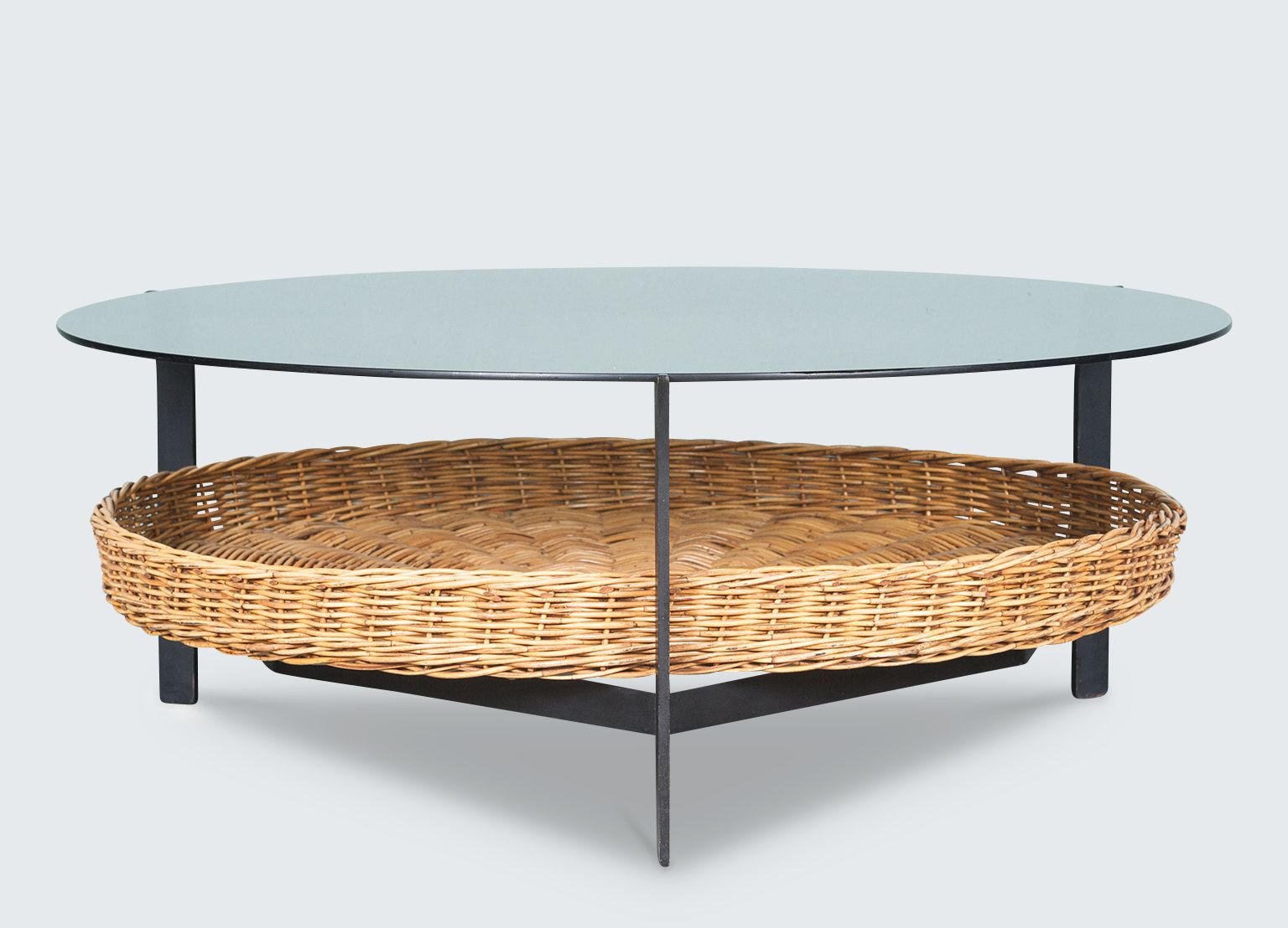 Dutch round coffee table with glass top and rattan basket