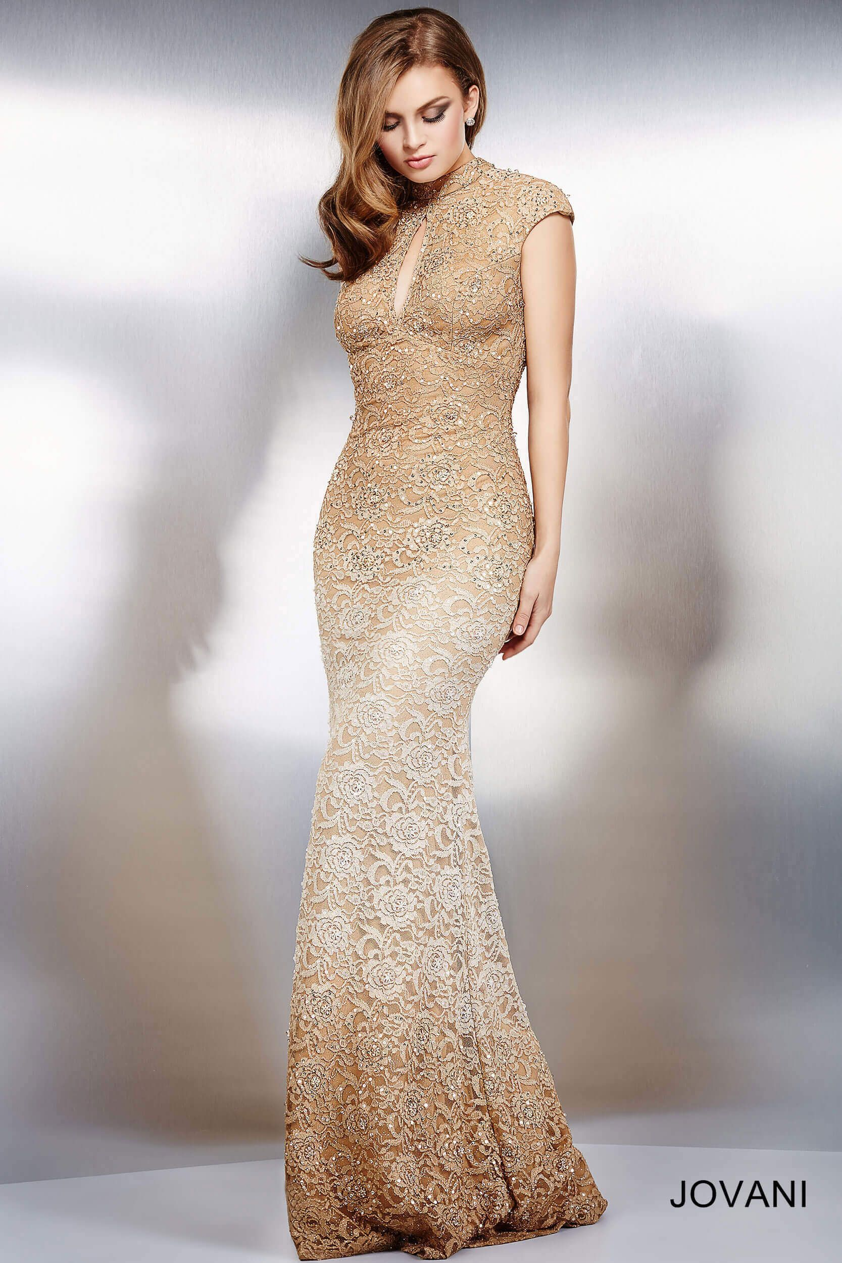 Stunning lace cap sleeve dress features a keyhole opening and gold