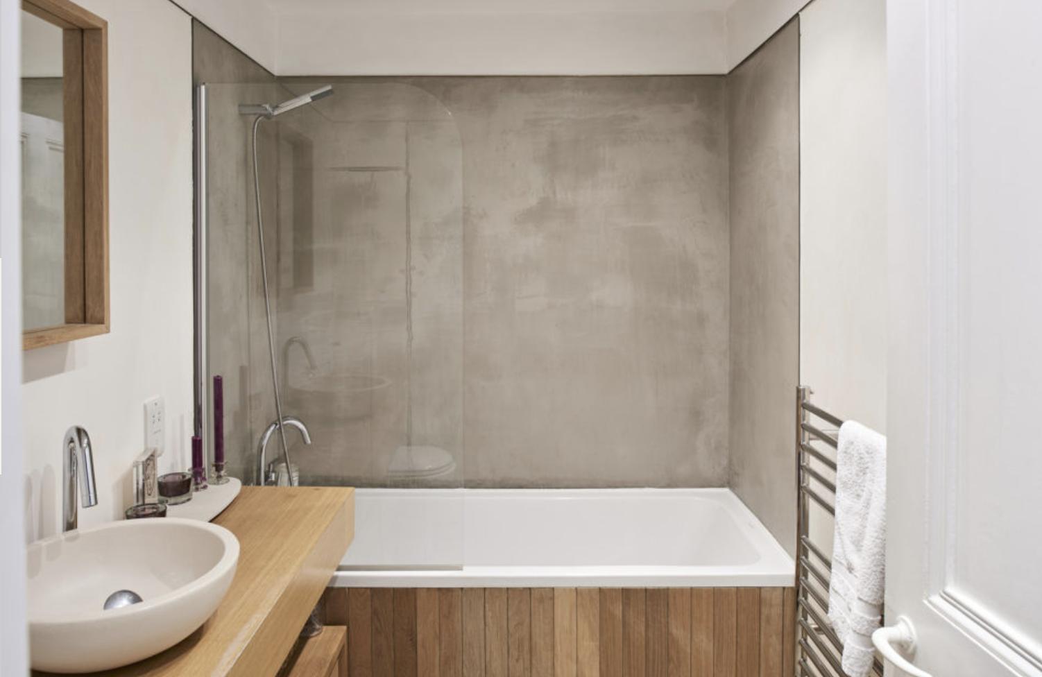 bathroom concrete bath wall  wooden panels  modern house