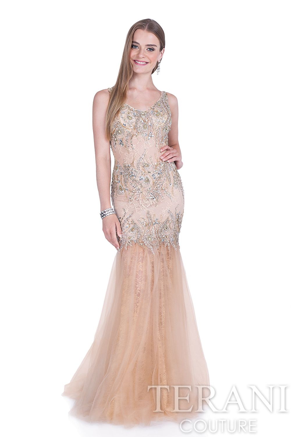 Lace mesh trumpet prom gown with crystal embellishments along the