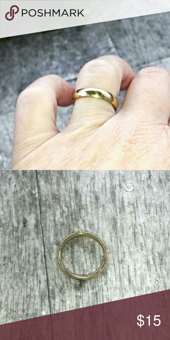 Simple Stainless Steel Gold Wedding Band This band measures 4mm. It's a simple band that'll look great worn alone, stacked, or with another ring. It'll hold up to everyday wear! -1 Jewelry Rings