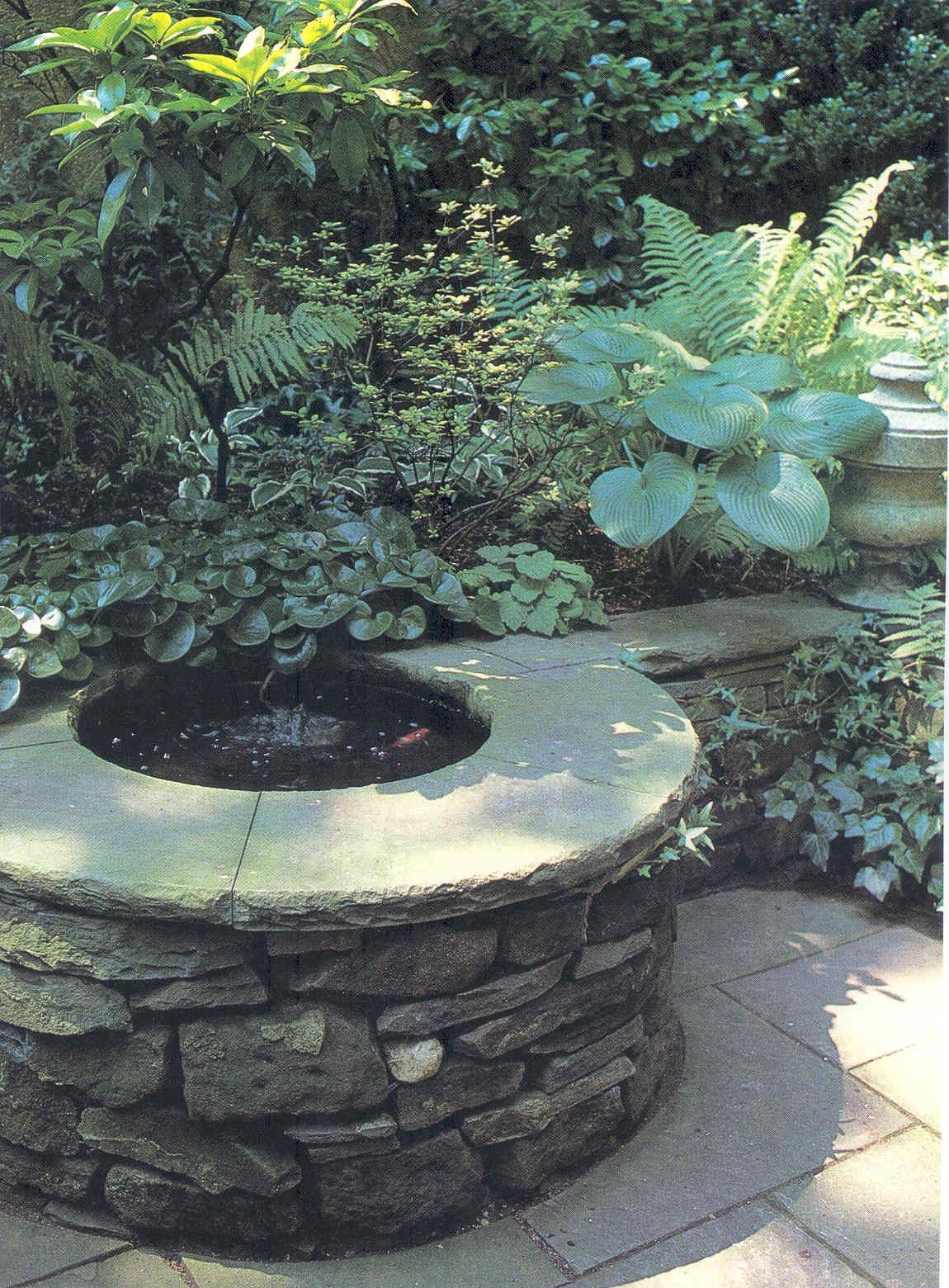Little goldfish pond in wall stone landscape walls for Pond shade ideas