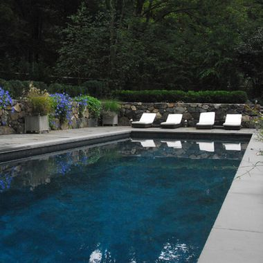 Gray Pool Plaster Colors Design For This Custom Gunite Swimming Pool Surrounded By Stone