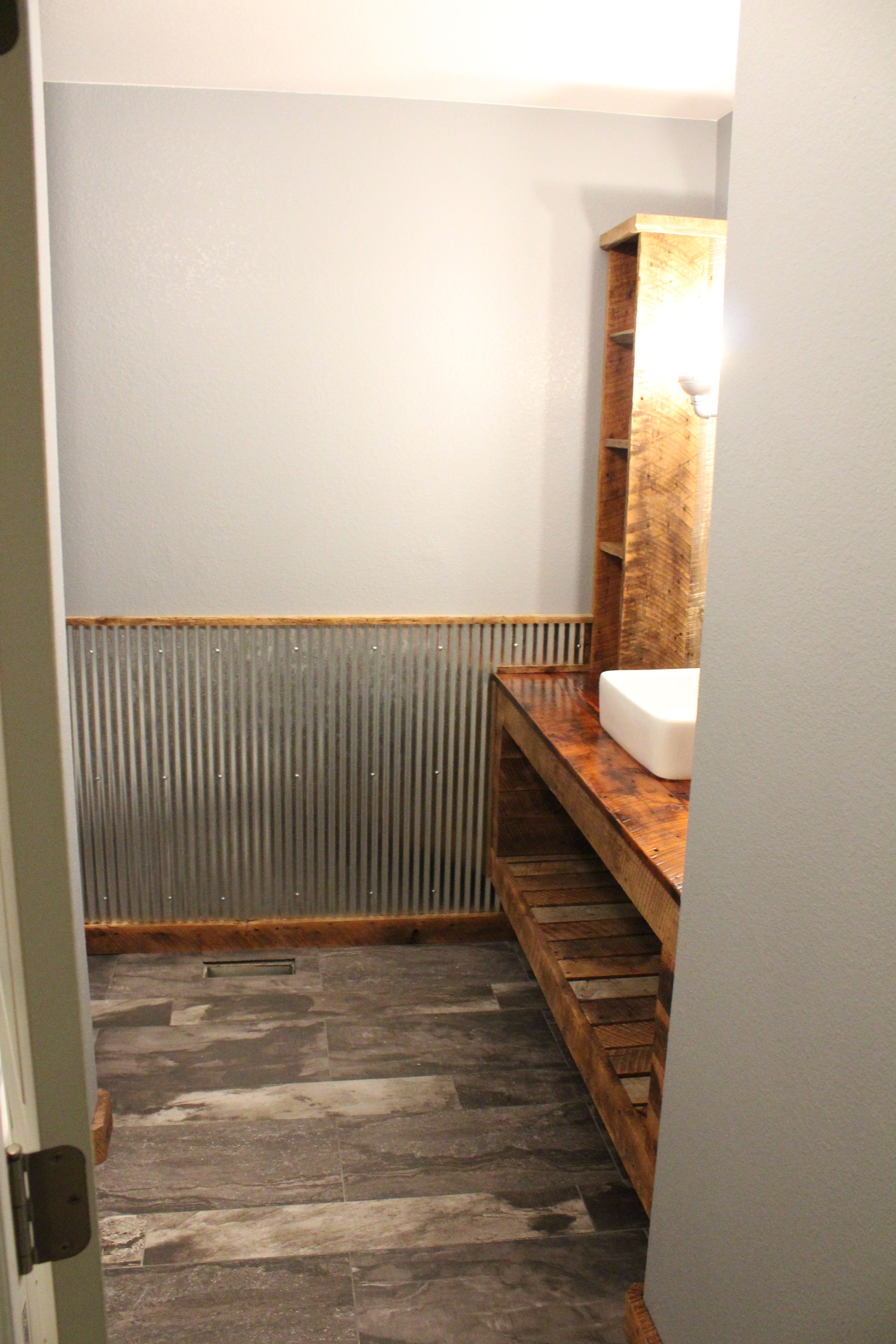 Used Metal Bathrooms : We used galvanized metal sheeting for wainscotting