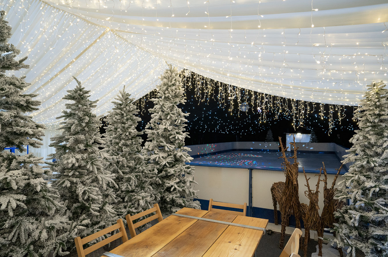 A wintery Christmas ice rink we installed. The icicle ...