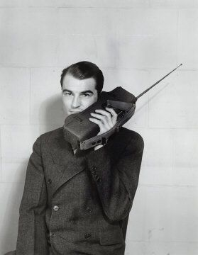 Motorola employee demonstrating use of a Handie-Talkie SCR536 portable two-way radio, circa 1941. Courtesy of Motorola Inc, Legacy Archives Collection.