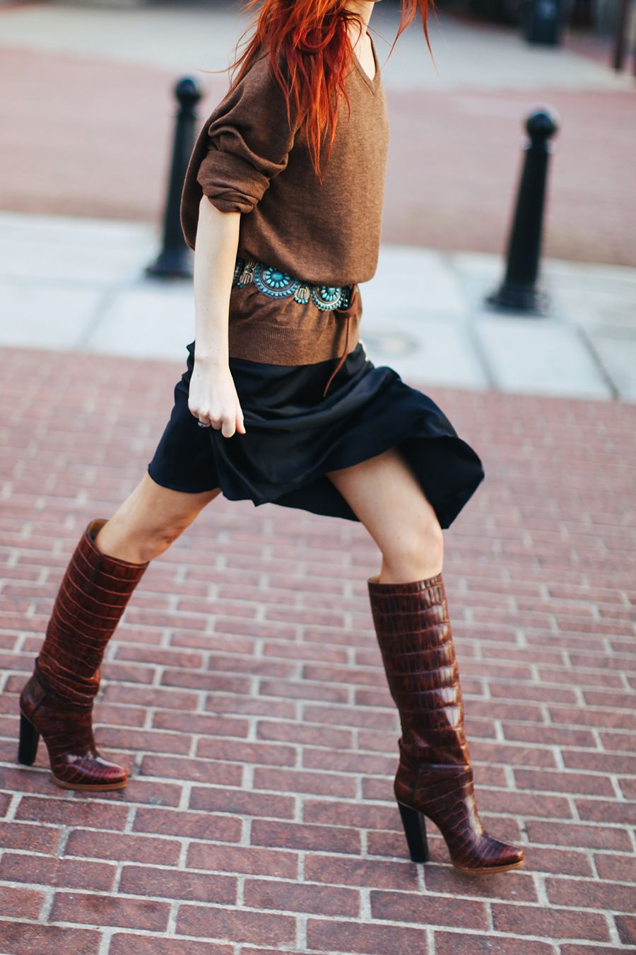 Wearing a black slip dress with a J. Crew sweater and vintage concho belt and Lucchese Mila boots.