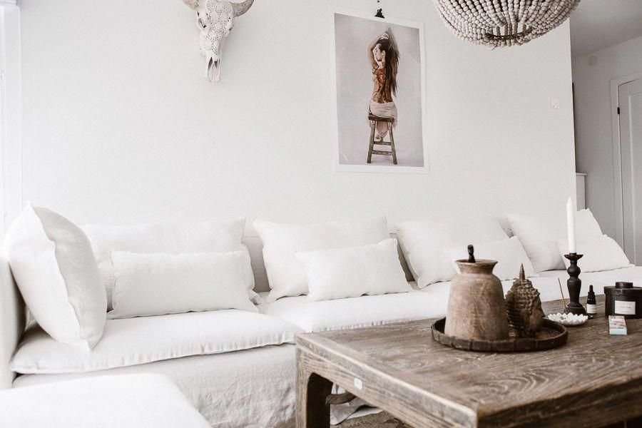boho chic living room  white linen sofa  touches of wood