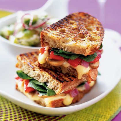 A great option for a meatless meal, this grilled panini sandwich features sauteed mushrooms, roasted red peppers, and gruyere cheese. | Health.com