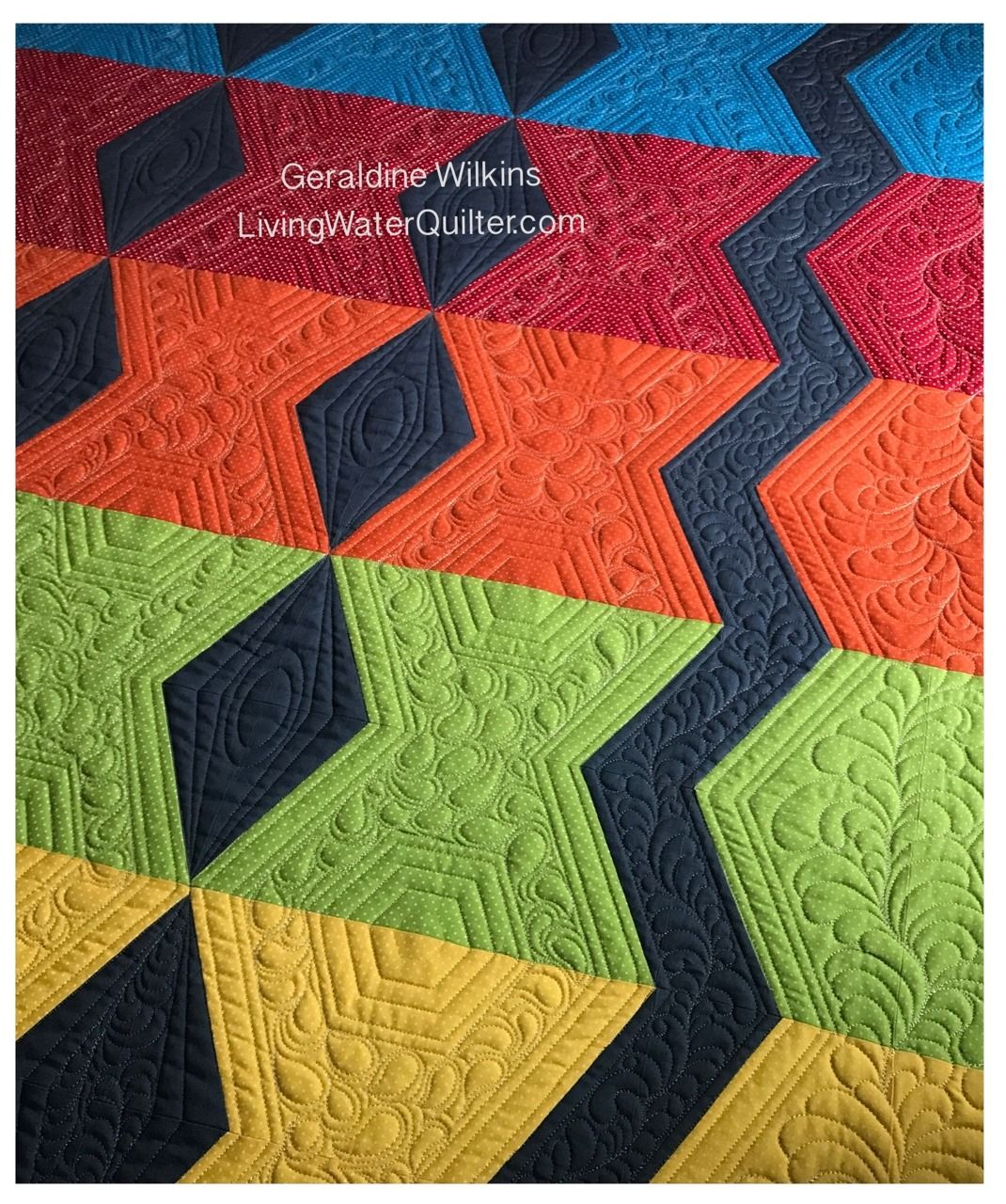 Geraldine Wilkins, LivingWaterQuilter.com - Free motion quilted feathers and ruler quilting with hexagons and ovals.