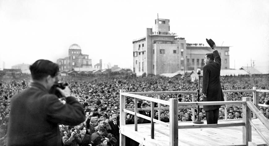 Emperor Hirohito, posthumously known as Emperor Showa, greets the crowd on Dec. 7, 1947, during his first visit to Hiroshima since the city was hit by an atomic bomb. As time heals the wounds of World War II, it has concealed many of the differences in opinion among survivors on both sides of the battle.