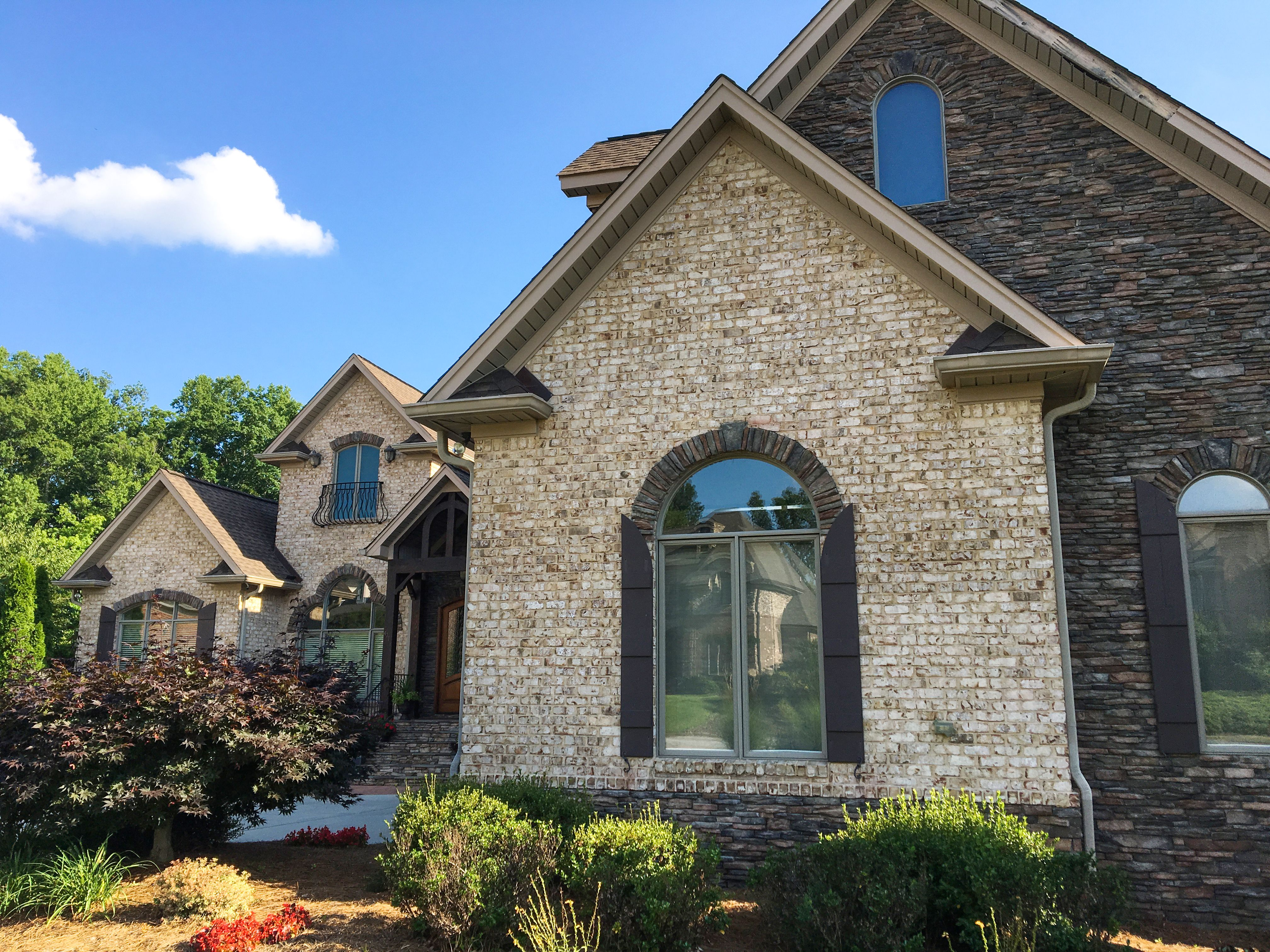 Mix A White Brick And Dark Stone For A Striking High Contrast Exterior Brick Shown Is Oyster Pearl Exterior Brick Brick Exterior House Stone Exterior Houses