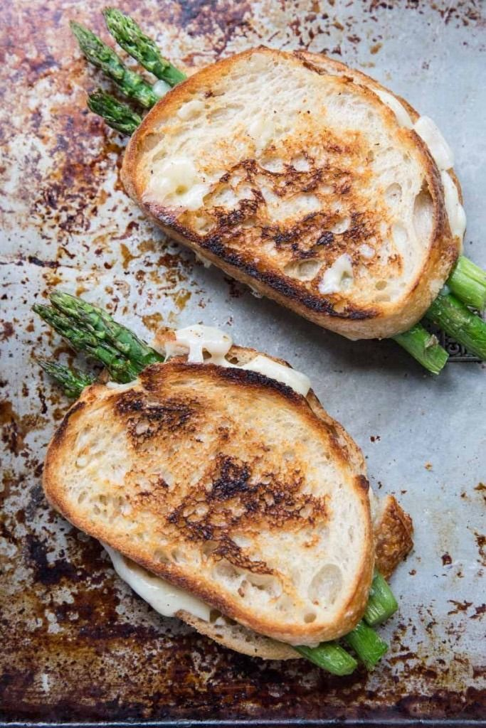 Because this sandwich only calls for five ingredients (not counting olive oil, salt, and pepper), this is the time to choose the best-quality ingredients you can find so they really shine. Pick up a bunch — you'll need six spears for two sandwiches — and roast it for a delicious grilled cheese filling