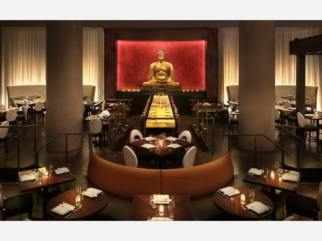 Hot Spot For Upscale Asian Fusion Dishes In A Sy Setting With Giant Buddha