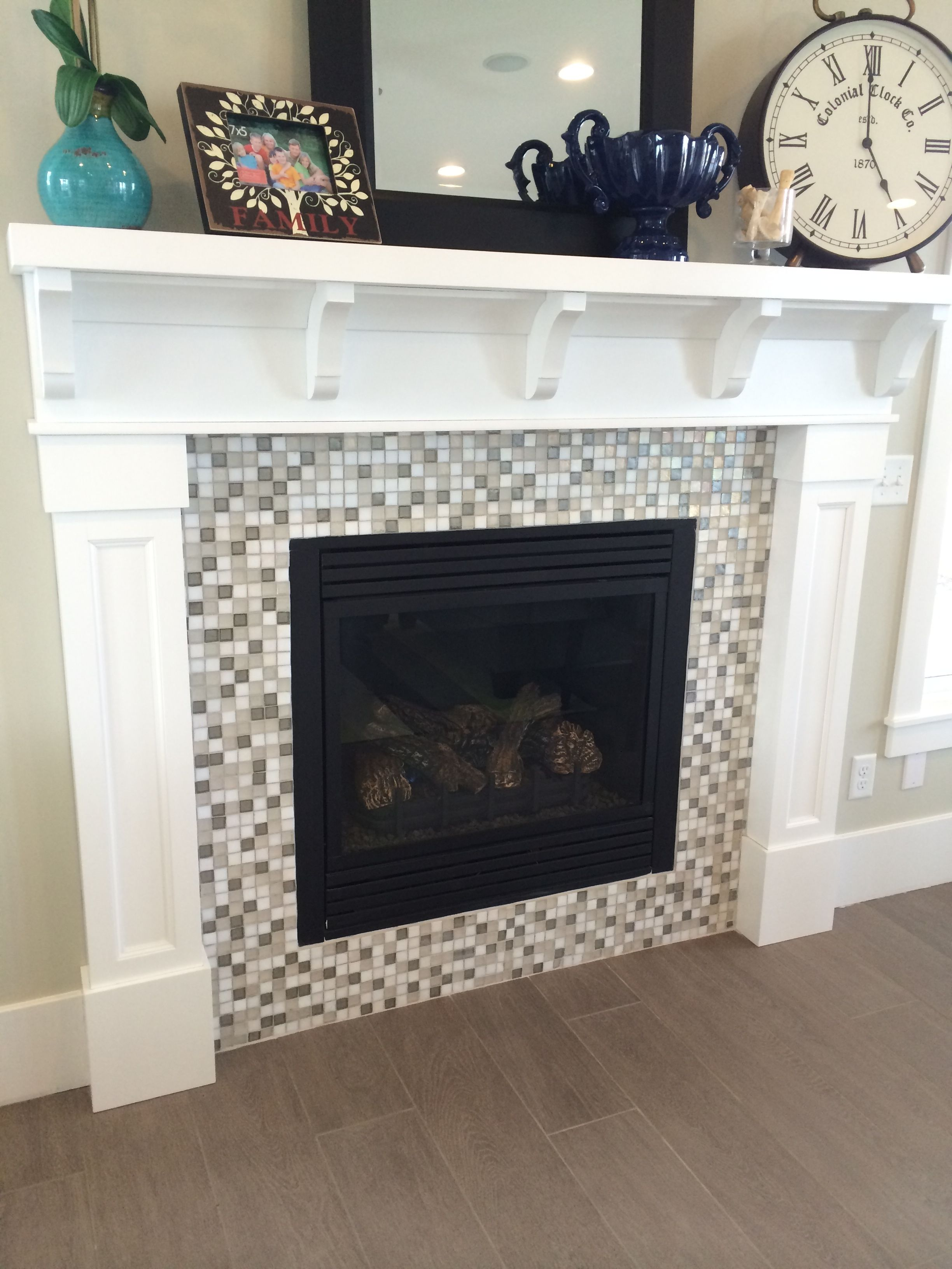 White craftsman fireplace mantel with mosaic tile surround for Craftsman fireplace pictures