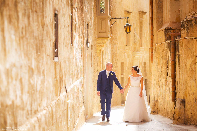 Destination Bride And Groom Walk Through The Medieval Streets Of Mdina In Malta P Destination Wedding Images Destination Bride Wedding Photography Inspiration