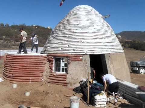Earthbag punish rock out to this great earthbag video by for Cost to build a house in little rock