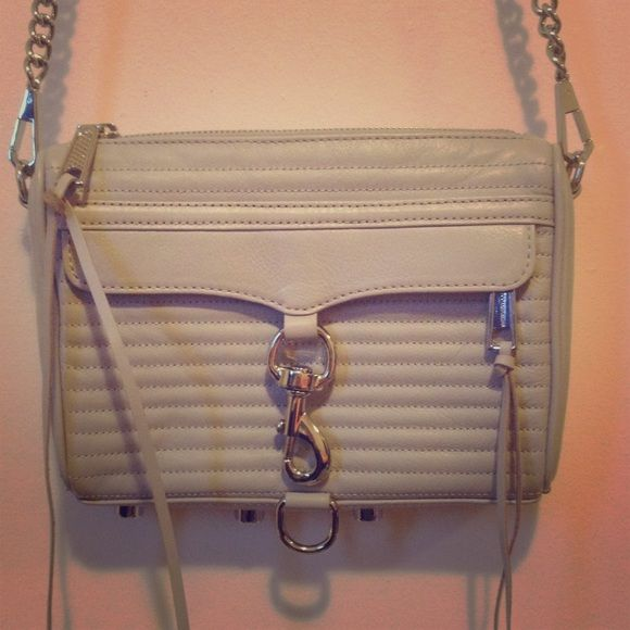 Rebecca Minkoff Mini MAC Crossbody Grey Bag Such a cute bag! In great pre-owned condition with one flaw: one of the buttons on the bottom of the bag has come off; please see pic. The color is a pretty light grey color. Rebecca Minkoff Bags Crossbody Bags