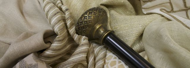 This finial looks perfect with these textured natural fabrics! www.drapery-design.com