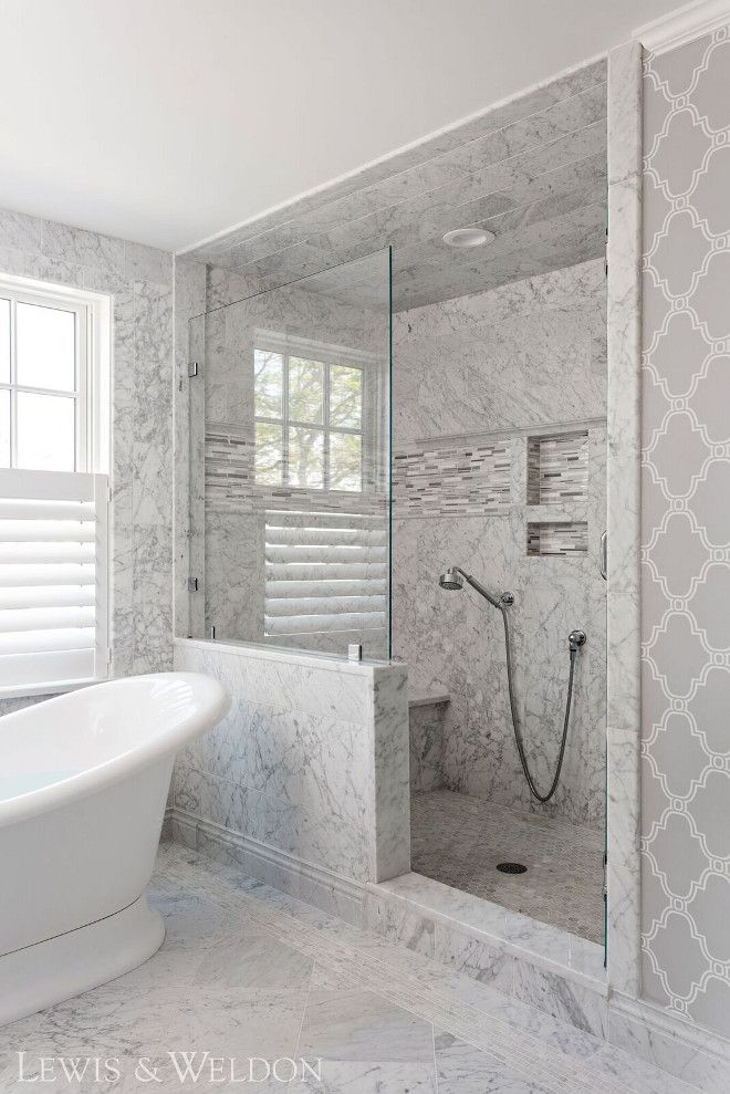 Marble Shower Tile This Shower Features Different Sizes Of Carrara Marble Tile From Floor Walk In Bathroom Showers Beautiful Bathroom Designs Bathroom Design
