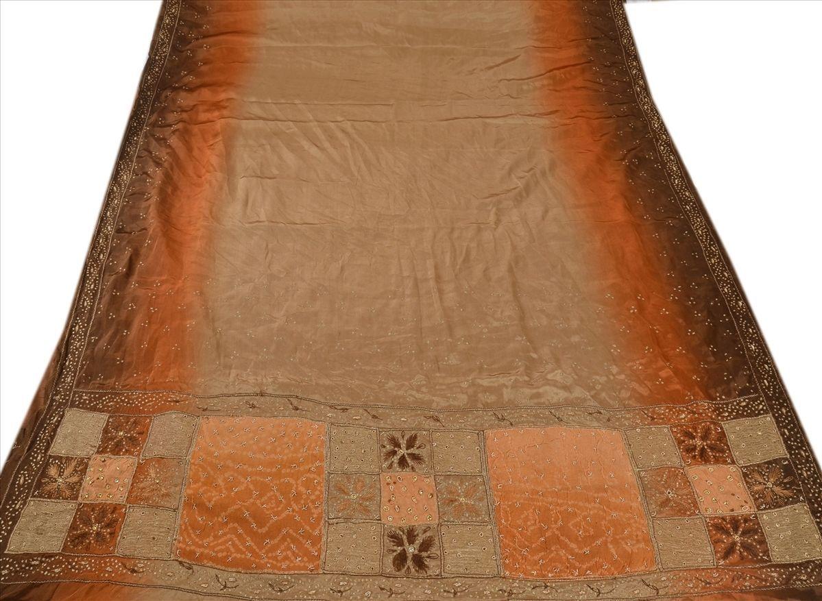 http://www.ebay.com/itm/SANSKRITI-VINTAGE-INDIAN-SAREE-HAND-BEADED-ZARI-FABRIC-ART-SILK-SARI-DECOR-BROWN-/141657004965?pt=LH_DefaultDomain_0