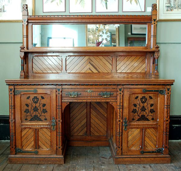 An Aesthetic movement inlaid oak sideboard