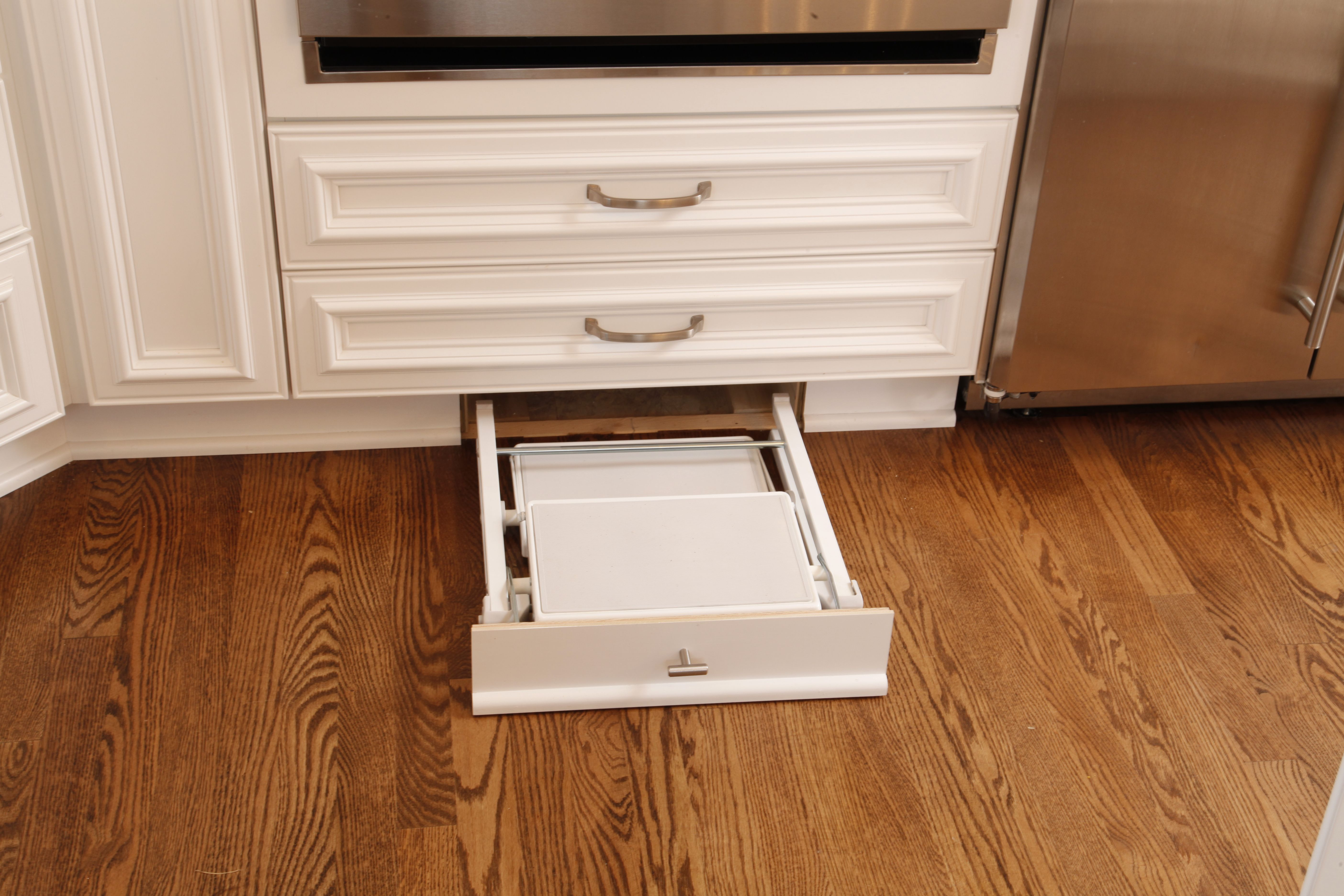 Toe kick step stool that unfolds and wheels around to ...