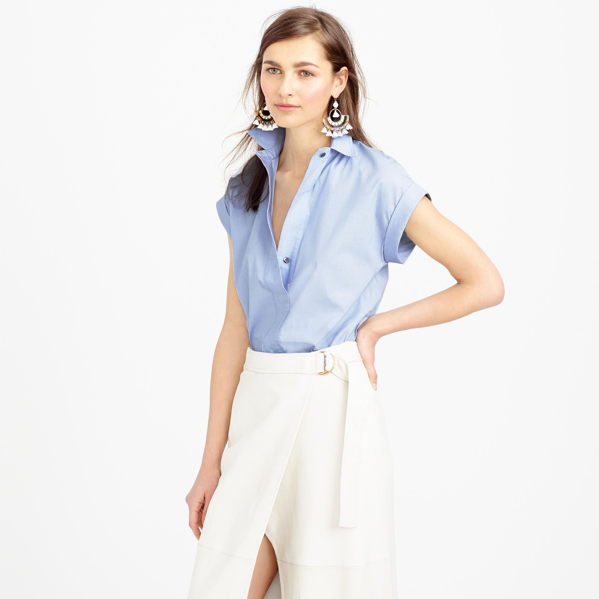 """This classic top has a wide placket that can be worn buttoned or unbuttoned, depending on your mood (and your outfit). It's made from crisp cotton and finished with cuffed sleeves and a shirttail hem, so it's easy but polished. That's what we call a win-win. <ul><li>Body length: 28"""".</li><li>Cotton.</li><li>Machine wash.</li><li>Import.</li><li>Online only.</li></ul>"""