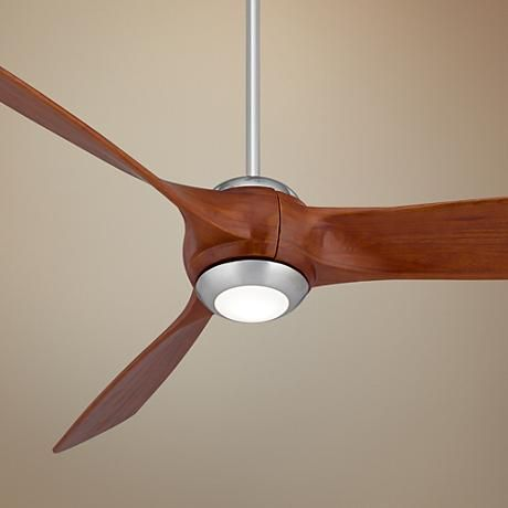 Carved solid wood blades bring a designer look of this energy efficient ceiling fan with led downlight