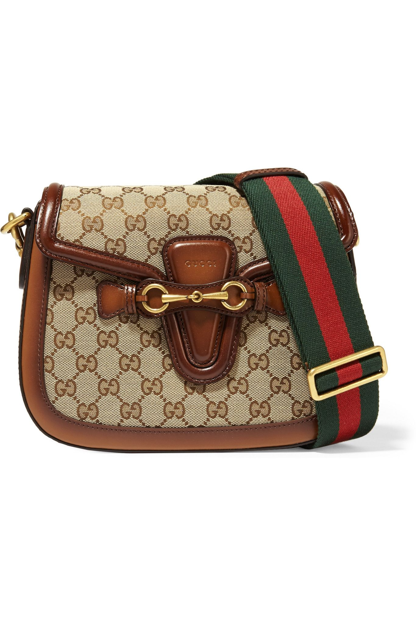 2b2aff68fca0 Go hands free this season and consider one of these crossbody bags. GUCCI Lady  Web medium leather-trimmed ...