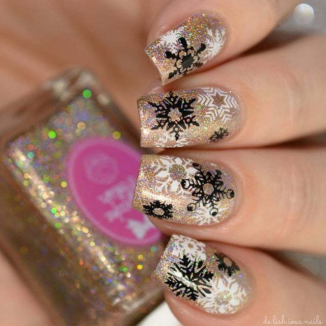 Snowflake nail art stamping design.