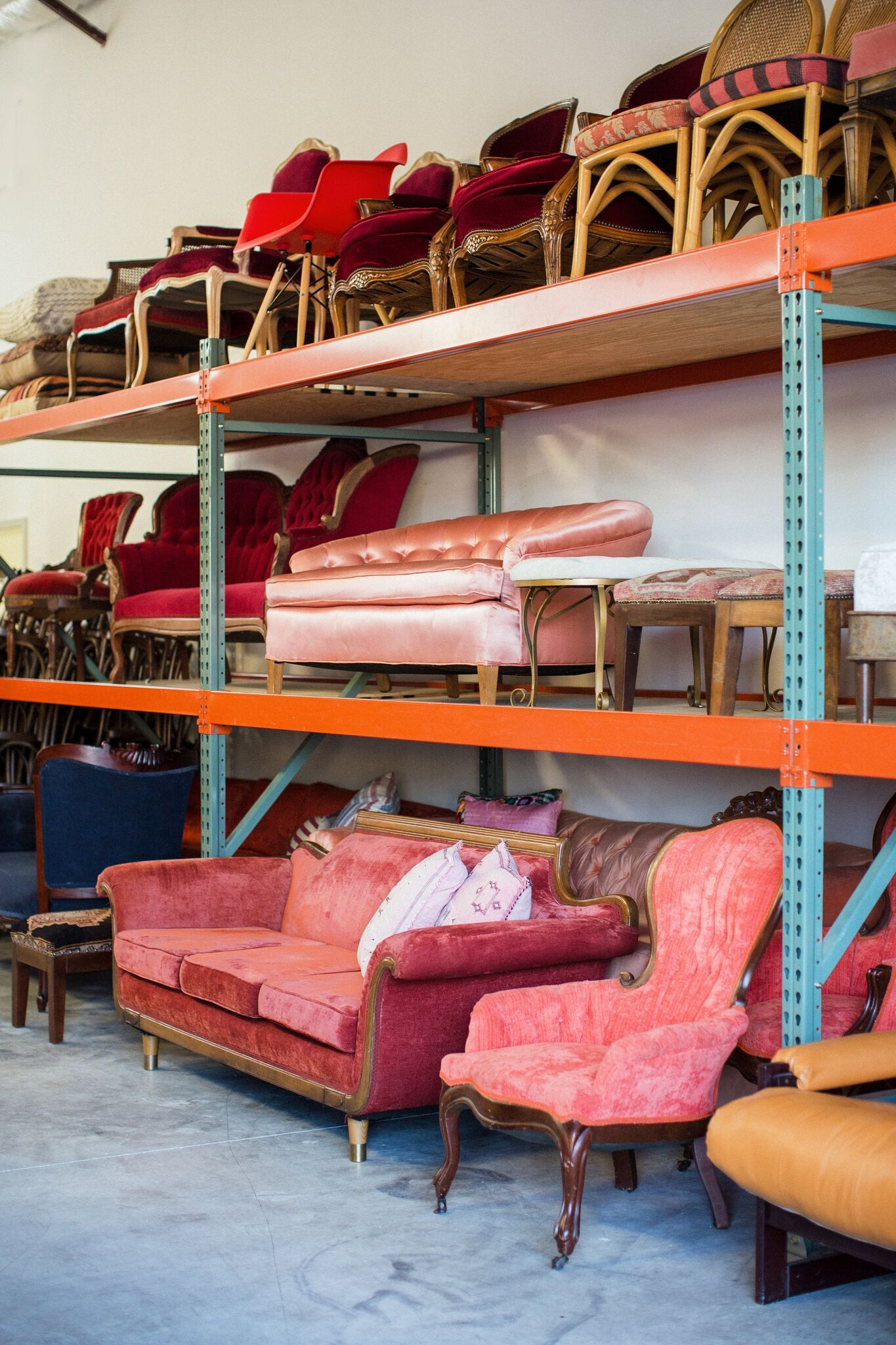 Wedding and event rental companys warehouse with colorful vintage furniture in austin texas via birch brass vintage rentals