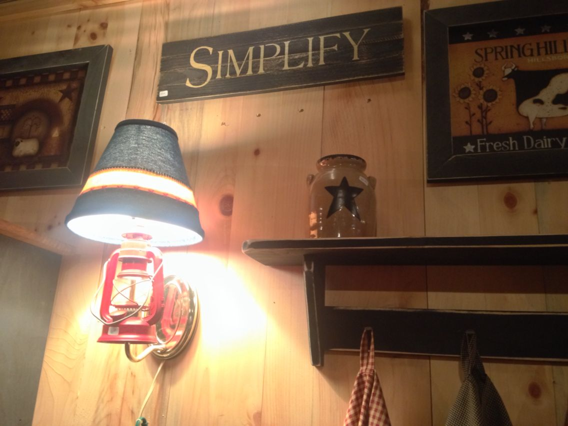 Love the wall lamp; primitive