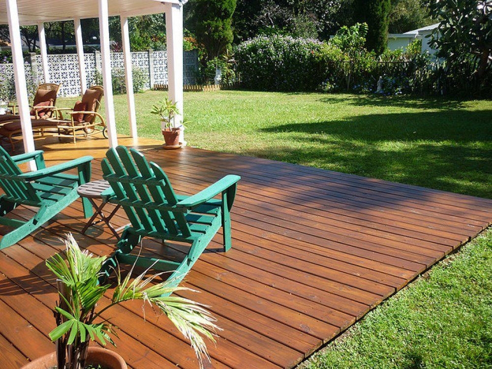 heres a gorgeous backyard ground level deck - Backyard Wood Patio Ideas