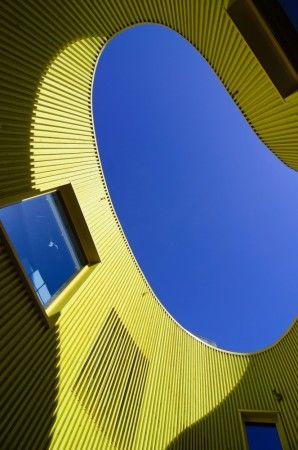 Yellow house, blue sky by Håkon Vestli
