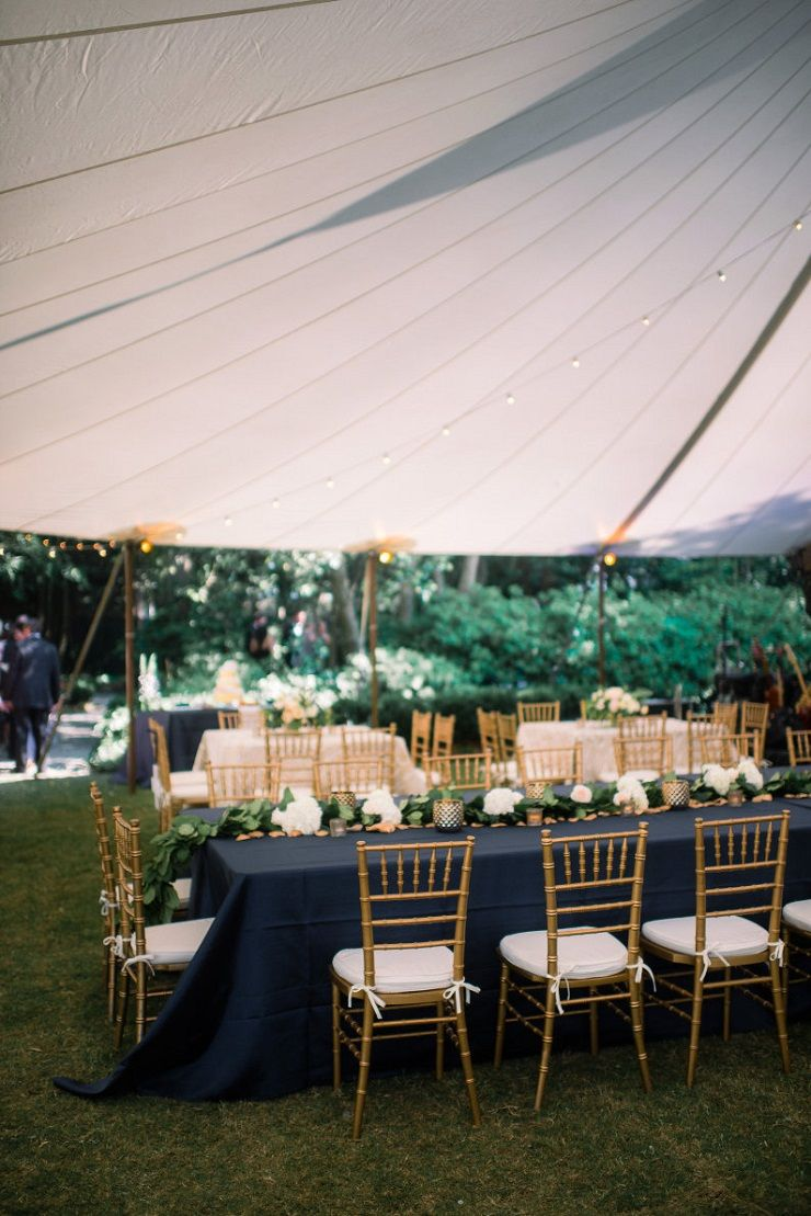 Dark blue and gold rustic elegant wedding reception under tent #weddingrecption #weddingdecor #weddinginspiration #rusticwedding