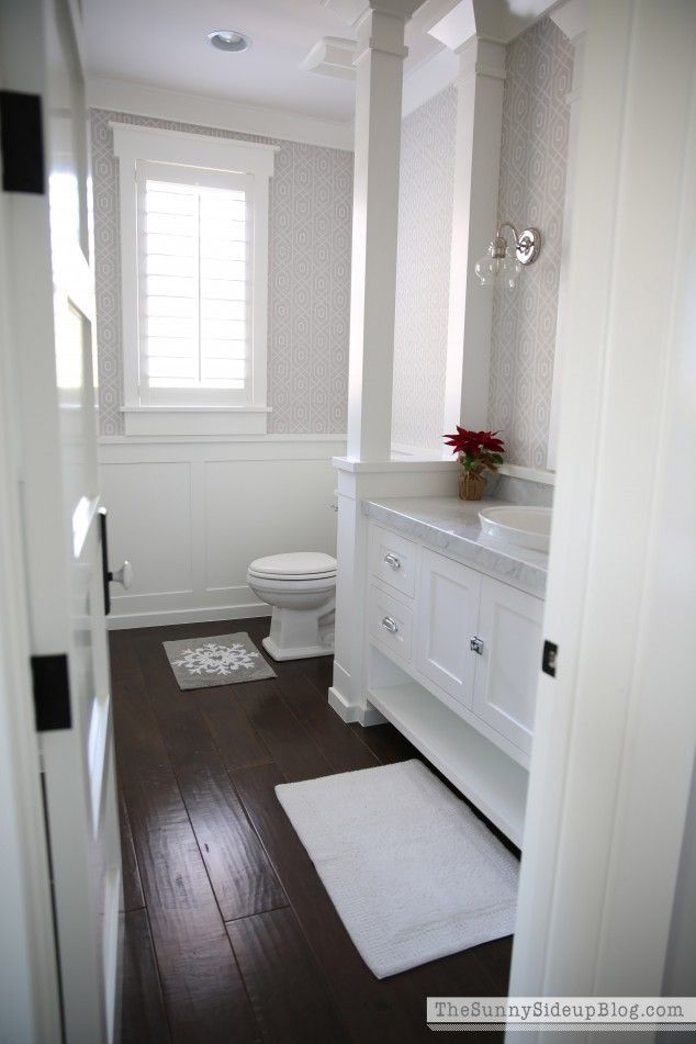 Sunny Side Up Shaker Panel Doors Blend Into This Crisp Clean Bathroom Visit Www Milettedoors White Bathroom Cabinets Wood Floor Bathroom Dark Floor Bathroom