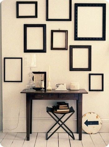 I love the idea of hanging empty frames as decor! Get them cheap at ...